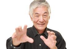 Senior Japanese man with supernatural power Stock Images