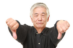 Senior Japanese man with thumbs down gesture Stock Photography
