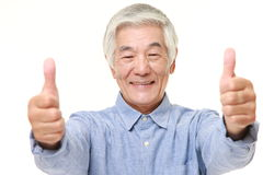 Senior Japanese man with thumbs up gesture Stock Photography