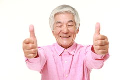 Senior Japanese man with thumbs up gesture Royalty Free Stock Photography