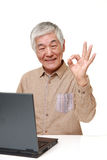 Senior Japanese  man using laptop computer Royalty Free Stock Images