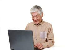 Senior Japanese  man using laptop computer Stock Image