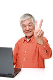 Senior Japanese  man using laptop computer Stock Photography