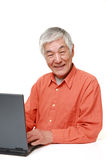 Senior Japanese  man using laptop computer Royalty Free Stock Image