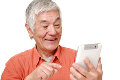 Senior Japanese man using tablet computer Stock Photography