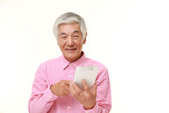 Senior Japanese man using tablet computer Royalty Free Stock Photography