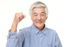 Senior Japanese man in a victory pose Stock Images