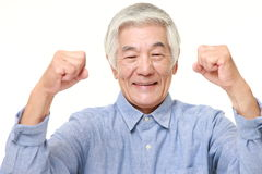 Senior Japanese man in a victory pose Royalty Free Stock Image