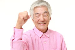 Senior Japanese man in a victory pose Royalty Free Stock Photography