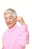 Senior Japanese man in a victory pose Royalty Free Stock Images