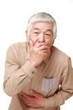 Senior Japanese man vomit Stock Photography