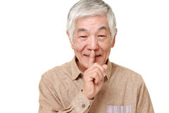 Senior Japanese man whith silence gestures Royalty Free Stock Photo