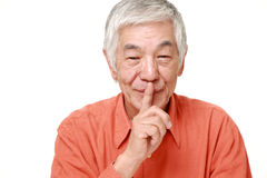 Senior Japanese man whith silence gestures Stock Images