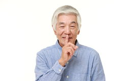 Senior Japanese man whith silence gestures Stock Photography