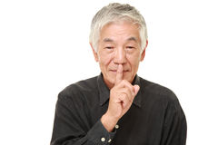 Senior Japanese man whith silence gestures Royalty Free Stock Image
