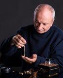 Senior jeweler looking at jewelry Royalty Free Stock Photo