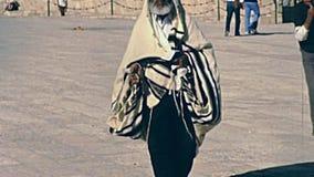 Senior Jewish man. Jerusalem, Israel - Circa 1981: Senior Jewish man in typical talled shawl with prayer book in hand, walking in Old City of Jerusalem, Western stock video footage