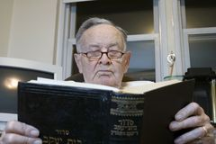Senior with Jewish Prayer Book. A senior Romanian Jewish man reads from his Jewish Prayer Book.  He was 91 years old at the time  of shoot and was photographed Royalty Free Stock Photos