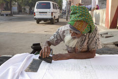 Senior Job. Sheoganj, India - January 2, 2012: an muslim old men manually print texure on white cloths, mostly people use this type of clothe for Curtain and bed Stock Photos