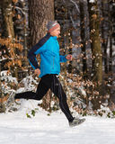 Senior jogging in the winter Royalty Free Stock Photo