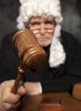 Senior judge in a courtroom striking the gavel Royalty Free Stock Photography