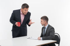 Senior and junior business people discuss Royalty Free Stock Photos