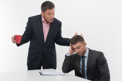 Senior and junior business people discuss Stock Image