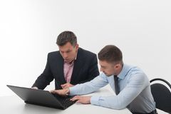 Senior and junior business people discuss Stock Images