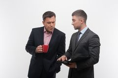 Senior and junior business people discuss Stock Image