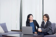 Senior and junior businesswoman discuss something during their m Royalty Free Stock Image