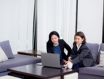 Senior and junior businesswoman discuss something during. Senior and junior businesswoman discuss something during their meeting Stock Photos