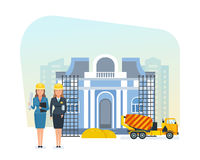 Senior and junior engineers stand on construction site for museum. Royalty Free Stock Photography