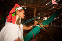 Senior of Kayan Lahwi woman is weaving. Royalty Free Stock Photography