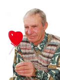 Senior keeping fake heart. Royalty Free Stock Image