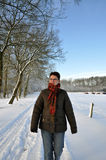 Senior keeping fit in winter snow period Stock Photos