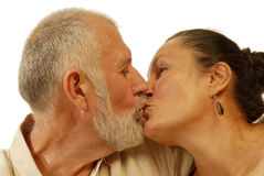 Senior kissing Stock Photography