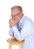 Senior kneeling and praying. Stock Photo