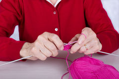 Senior is knitting Stock Images