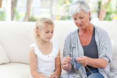 Senior knitting with her granddaughter Royalty Free Stock Image