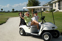Senior ladies in golf cart royalty free stock image