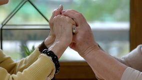Senior ladies holding hands. Two old women. Friend will always support you stock footage