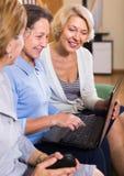 Senior ladies with laptop royalty free stock photography