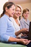 Senior ladies with laptop stock image