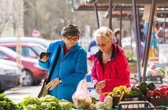 Senior ladies at market Stock Image