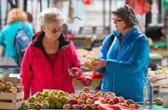 Senior ladies at market Stock Photography