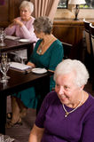 Senior ladies in restaurant Stock Image