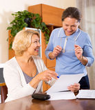 Senior ladies signing documents Royalty Free Stock Images
