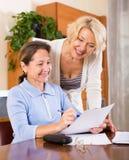 Senior ladies signing documents Stock Photo