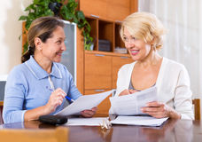 Senior ladies signing documents Royalty Free Stock Photo