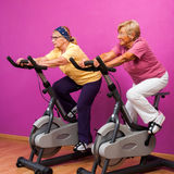 Senior ladies at spinning session. Stock Photo